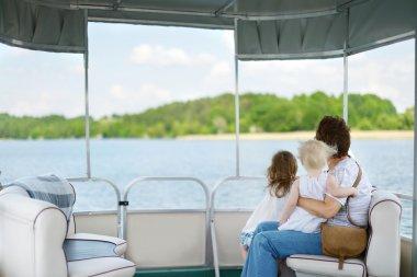 Happy family having fun on a sailboat