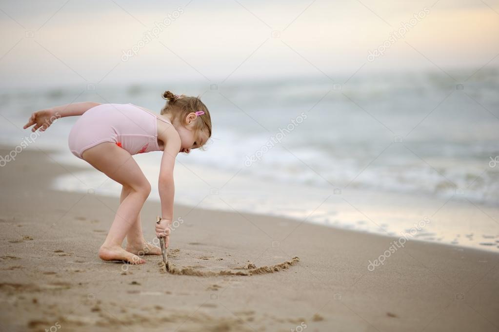 Little girl on a sand beach