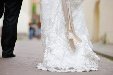 Bride and groom legs walking away