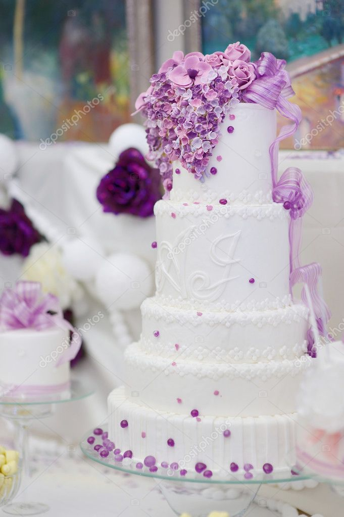 White wedding cake decorated with purple flowers stock photo white wedding cake decorated with purple flowers stock photo mightylinksfo