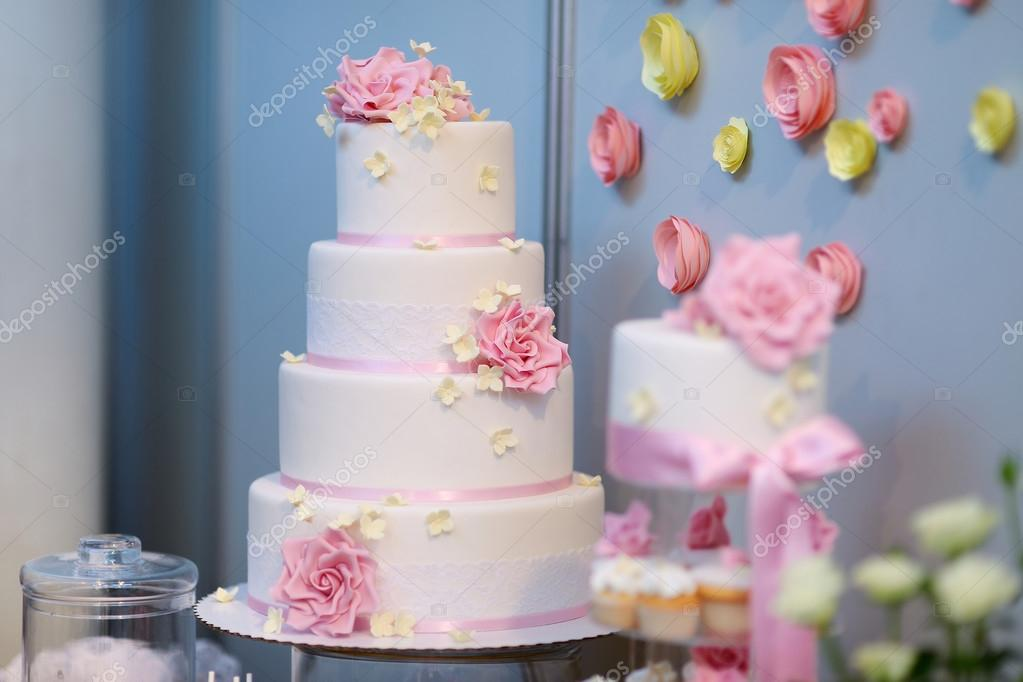 White wedding cake decorated with pink flowers stock photo white wedding cake decorated with pink flowers stock photo mightylinksfo Image collections