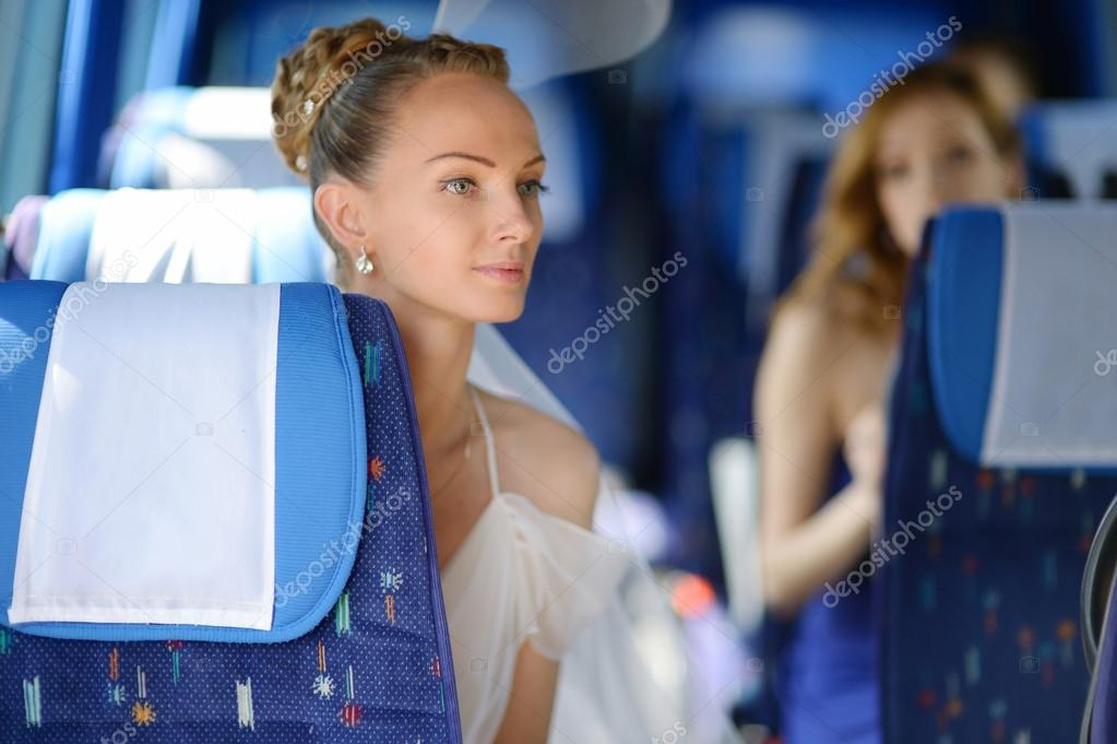 Beautiful young bride portrait in a bus