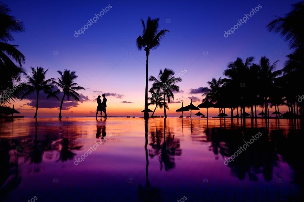 Young couple at scenic sunset