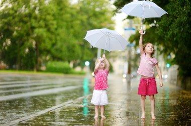 Sisters under rain