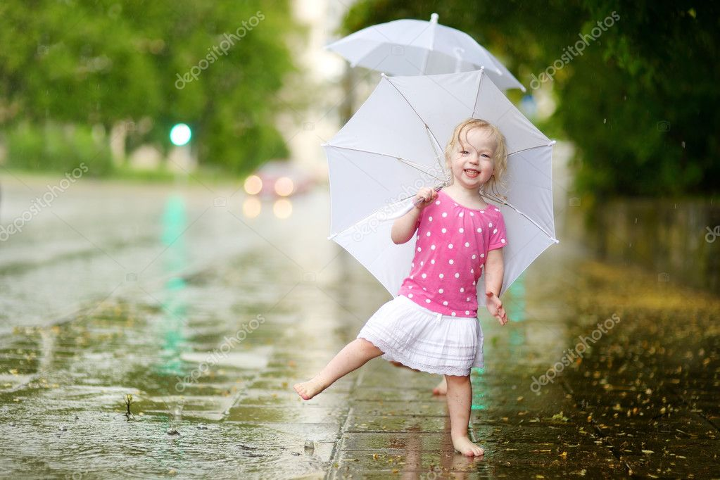 little girl under   rain