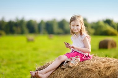Adorable girl in wheat field