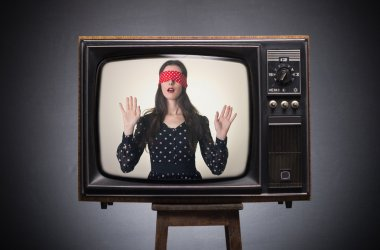 Blindfolded girl on old TV screen.