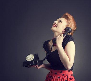 Woman talking on land line phone