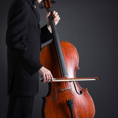 Cellist playing classical music on cello