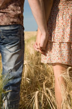 Loving couple holding hands on nature