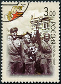 RUSSIA - 2005: shows welcome of victors in Moscow, 1945 (soldiers holding flowers), 60th anniversary of Victory in the Great Patriotic War of 1941-1945