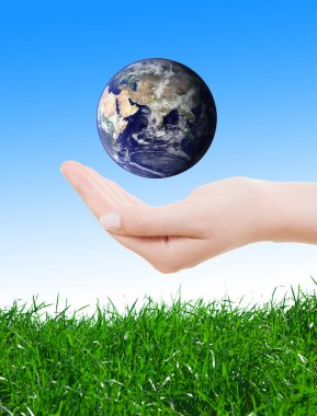Hand holding earth, saving earth concept.