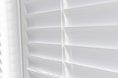 Metal Blinds with drawstring.
