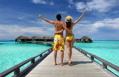 Fotografie Couple on a beach jetty at Maldives