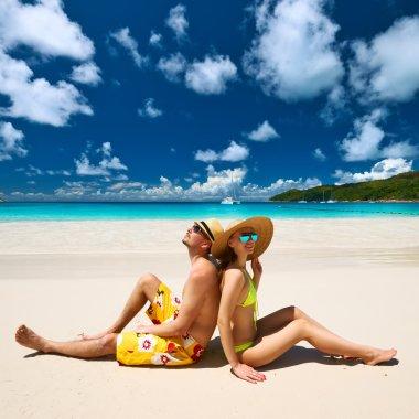 Couple on a tropical beach at Seychelles stock vector