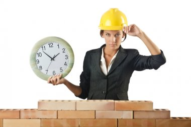 Female builder and clock on white