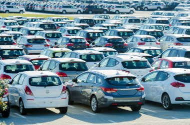 TUSCANY, ITALY - 27 June: New cars parked at distribution center