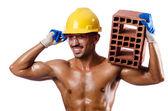 Nahý stavební dělník na bílém