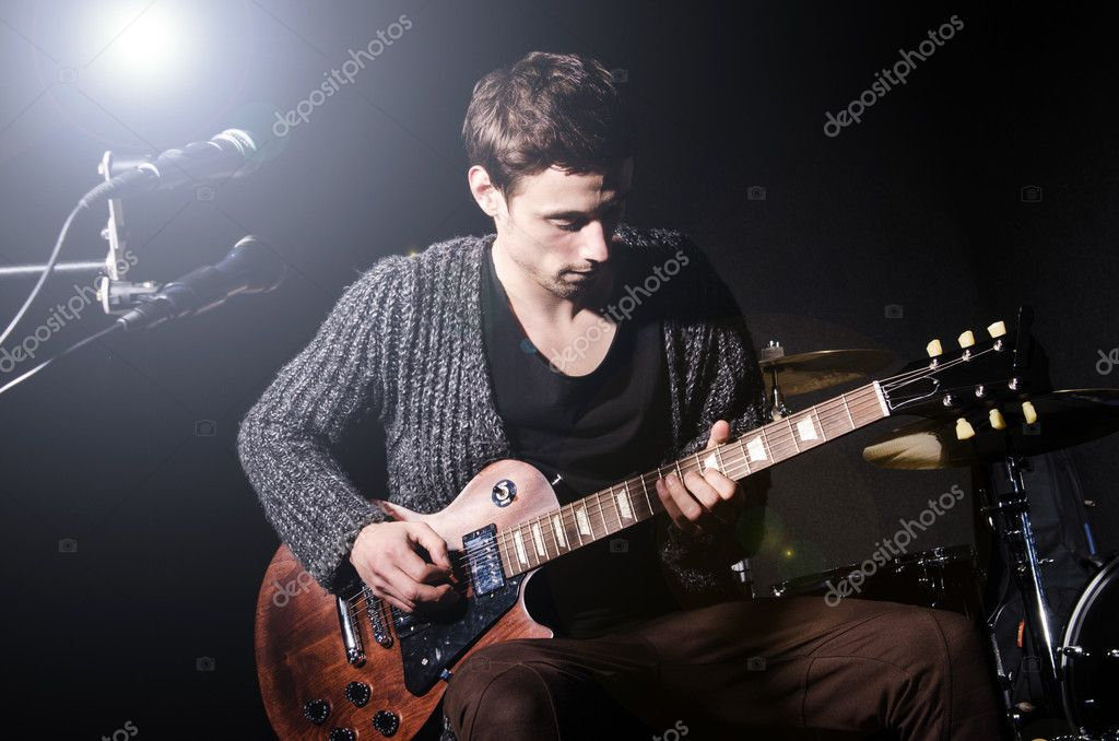 Man playing guitar during concert