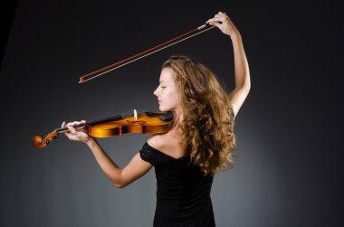 Attractive woman with cello in studio