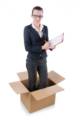 Woman with paper pad out of box