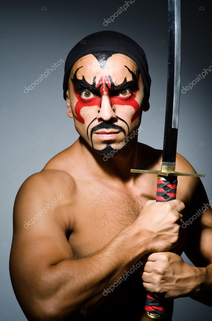 Man With Sword And Face Paint Stock Photo C Elnur 30887345