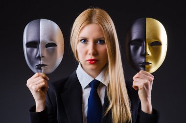 Woman with two masks in hypocrisy concept