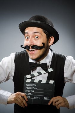 Man with movie clapper board