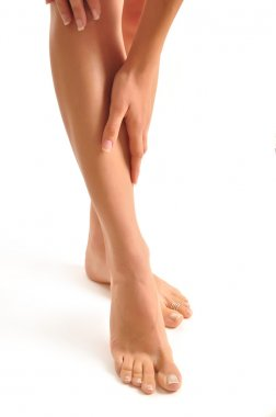 Woman holding sore leg