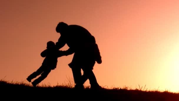 Father catch children sunset