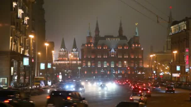 Moving cars in moscow night street, red square in background