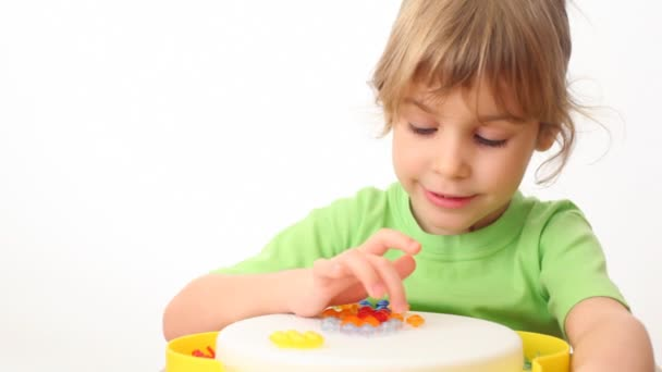 small girl counts multi-coloured buttons in toy