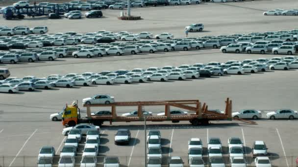 Parking of cars, loading of cars on a lorry, on sunny day. Time lapse.