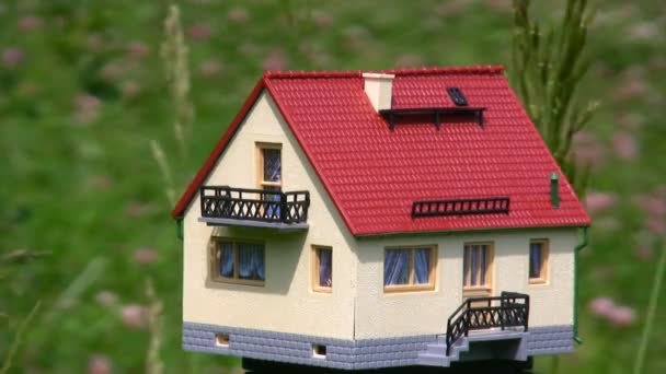 Toy house standing in park