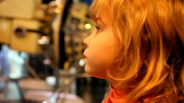 Little girl in the space museum