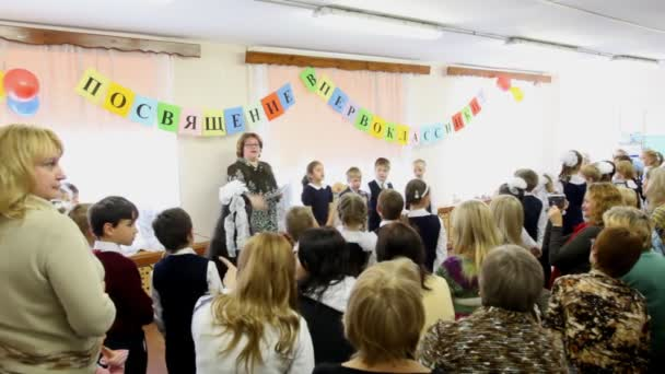 Children read oaths at dedication meeting in first-graders of school number 1349 in Moscow.