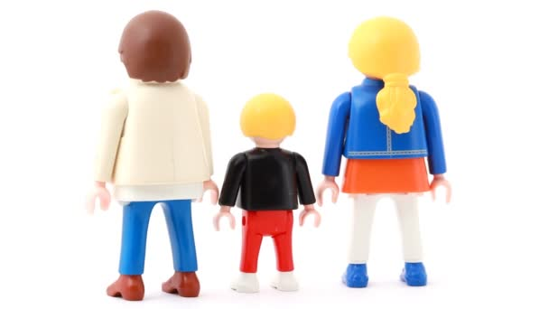 Toy family is located on a rotating stand