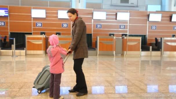 Woman and girl at airport