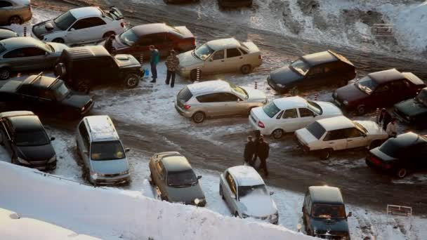 Cars stand on a parking in winter
