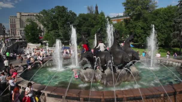 Kids bath in fountain Seasons on Manege Square