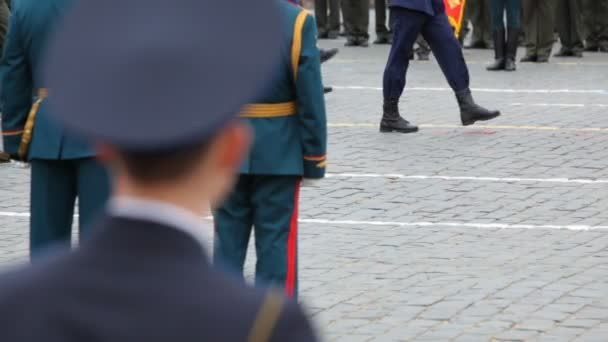 Panorama following legs soldiers march at military parade