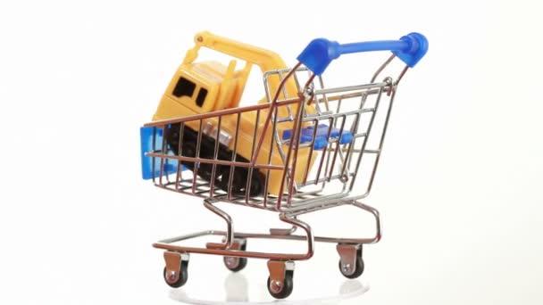 Truck-mounted crane toy inside shopping cart turning around on platform