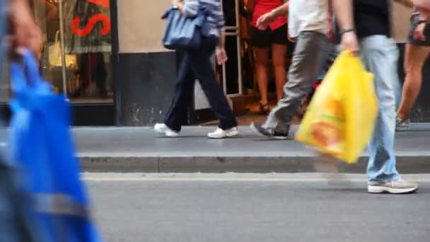People legs in summer shoes go to shop in sunny day