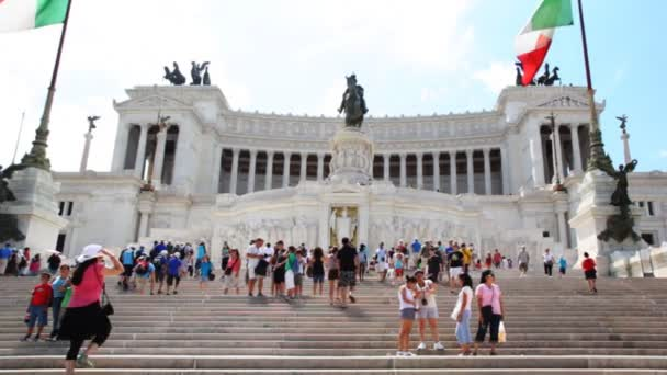 Brisk movement of people on stairs Venice Square near monument in honor Victor Emmanuel II