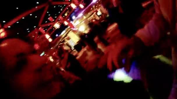 Happy couple dances on dance-floor in night club