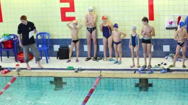 Training swim of table tennis team in swimming pool