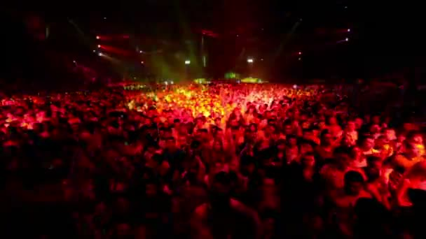 Audience in large stadium at rave party