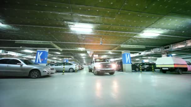 Wrecker, with flasher on, turns inside parking garage