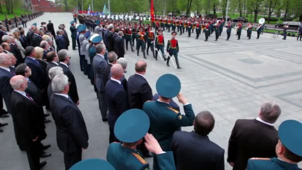 Russian top officials watch navy, air and land forces ranks of soldiers march with rifles