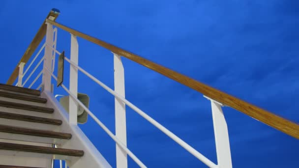 Ladder on cruise liner deck at evening, time lapse
